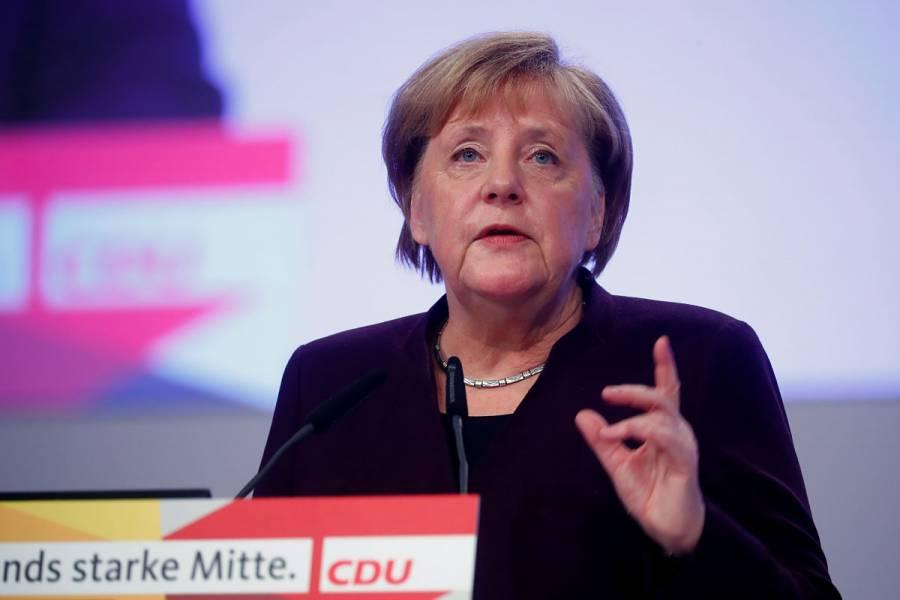Merkel defiende la OTAN tras las críticas de Macron
