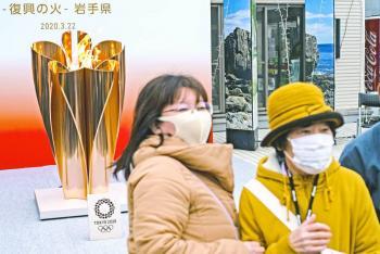 Japón reúne a 50 mil para ver la antorcha olímpica