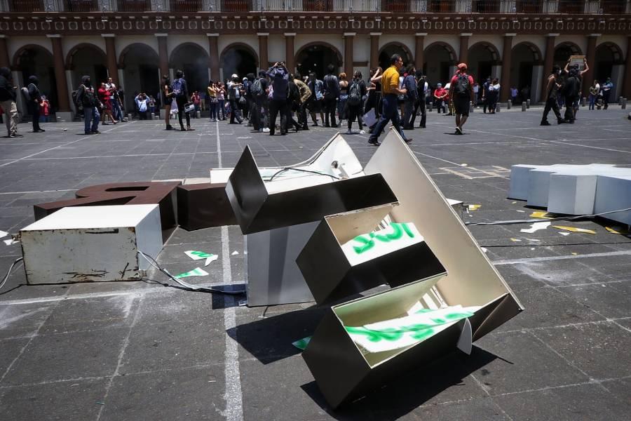 Manifestación en Veracruz deja edificios y negocios con daños