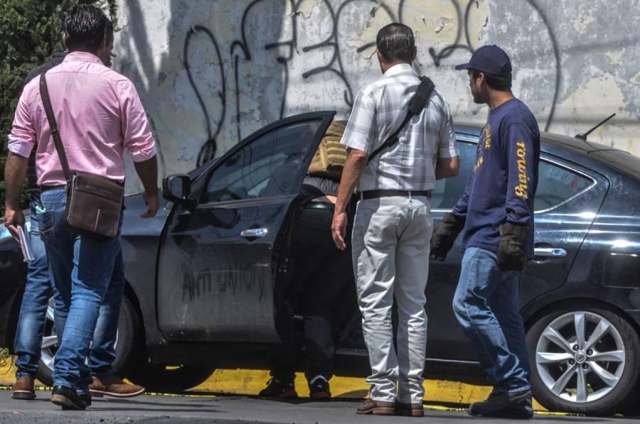 Hallan cuatro cadáveres al interior de un auto de lujo en Tlalpan