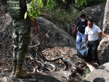Fosa clandestina es hallada con 22 cuerpos en Colima