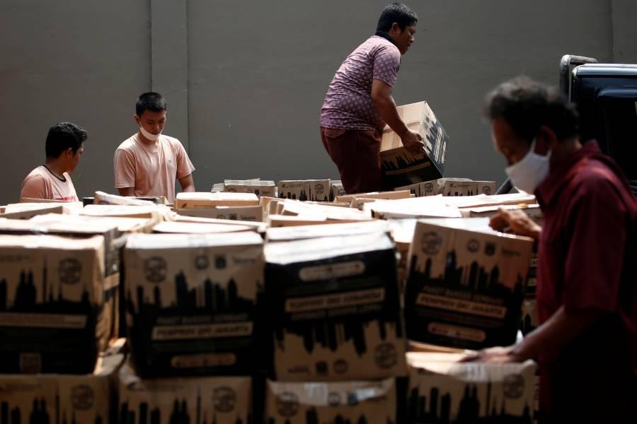 OMS minimiza peligro de que el COVID-19 pase a paquetes de comida
