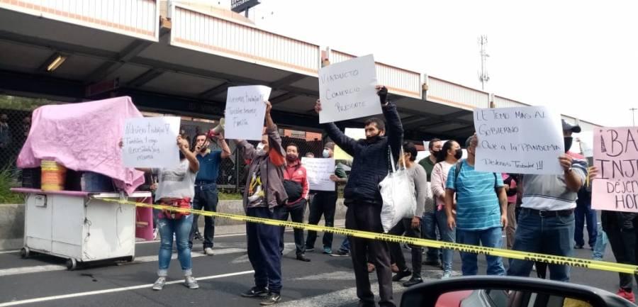 Enfrentamiento entre comerciantes y personal de la alcaldía Iztacalco en Tlalpan
