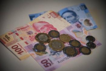 Peso mexicano cae y rompe barrera de 20/dlrc